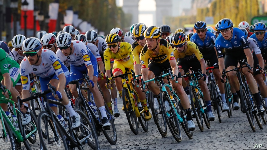 Cyclists ride down Champs Elysees with the pack during the twenty-first and last stage of the Tour de France cycling race over 122 kilometers (75.8 miles), from Mantes-la-Jolie to Paris, France.