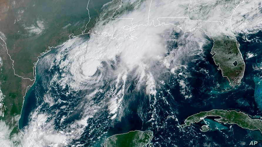 This GOES-16 GeoColor satellite image taken on Sept. 19, 2020, and provided by NOAA, shows Tropical Storm Beta, in the Gulf of Mexico.