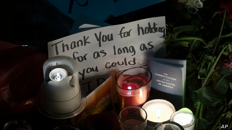 Candles and messages are left on the sidewalk in front of the Supreme Court to honor the late Justice Ruth Bader Ginsburg, in Washington, Sept. 19, 2020.