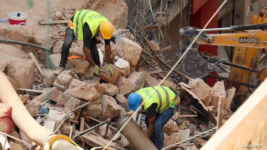 Volunteers dig through the rubble of collapsed buildings after signs of life were detected in a neighborhood of Beirut, Lebanon, Sept. 5, 2020, devastated by a massive blast Aug. 4, 2020.
