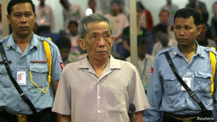 FILE - Former Khmer Rouge prison chief Kaing Guek Eav, better known as Duch, stands in a courtroom during a pre-trial hearing, in Phnom Penh, Cambodia, Dec. 5, 2008.