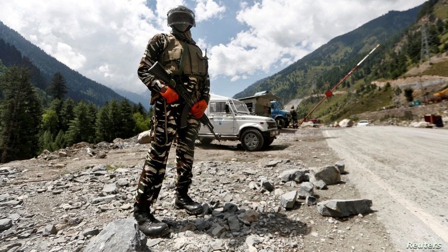 FILE - An Indian Central Reserve Police Force (CRPF) member stands guard at a checkpoint along a highway leading to Ladakh, at Gagangeer, in Kashmir's Ganderbal district, Sept. 2, 2020.