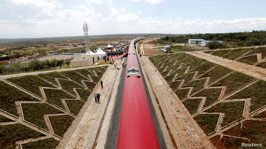 FILE - An aerial view shows a train on the Standard Gauge Railway (SGR) line constructed by the China Road and Bridge Corporation (CRBC) and financed by the Chinese government, in Kimuka, Kenya, Oct. 16, 2019.