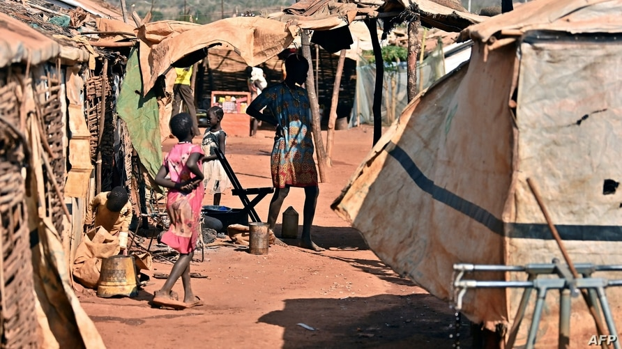 Young girls prepare for some chores outside their family's shelters at the Protection of Civilians (POC) site in Wau on…