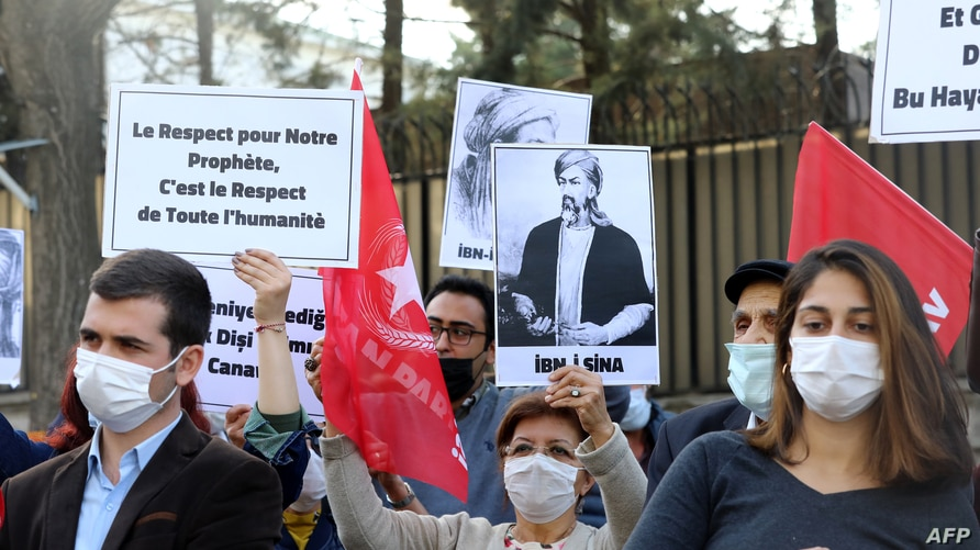 """Demonstrators hold a sign reading """"Respect for our prophet is respect for all mankind"""" during a demonstration protesting the…"""