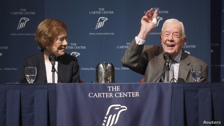 """Former U.S. President Jimmy Carter gestures as he answers questions during """"A Conversation with the Carters,"""""""