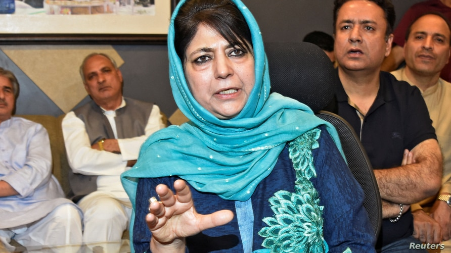 FILE - Former Jammu and Kashmir Chief Minister Mehbooba Mufti gestures as she addresses a news conference in Srinagar, June 19, 2018.