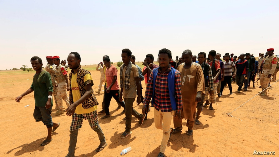 Irregular migrants from Ethiopia, Sudan and Chad who were abandoned by traffickers in a remote desert area near the Libyan…