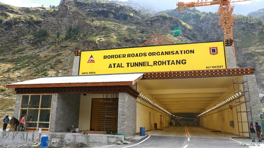 Labourers work next to the newly constructed Atal Tunnel on the Leh-Manali highway in Sissu village in Lahaul and Spiti…