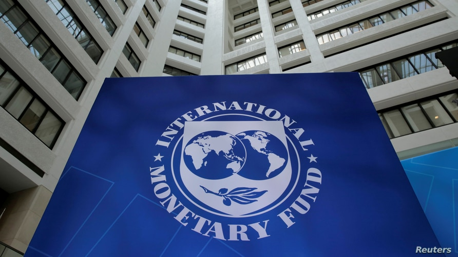 FILE PHOTO: FILE PHOTO: The International Monetary Fund logo is seen during the IMF/World Bank spring meetings in Washington, U…