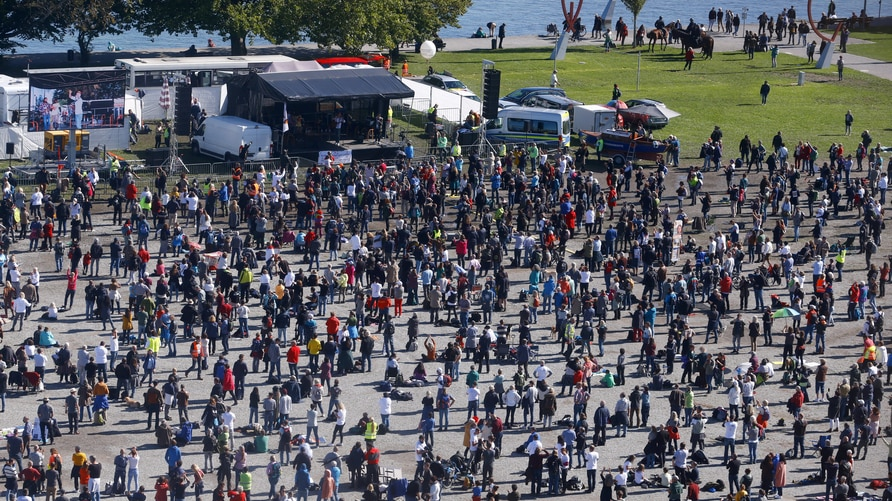 A general view taken from a wheel shows people gathering during a protest against the government's restrictions, amid the…