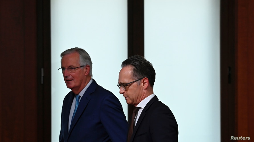German Foreign Minister Heiko Maas and the European Union's Brexit negotiator Michel Barnier leave after addressing the media…