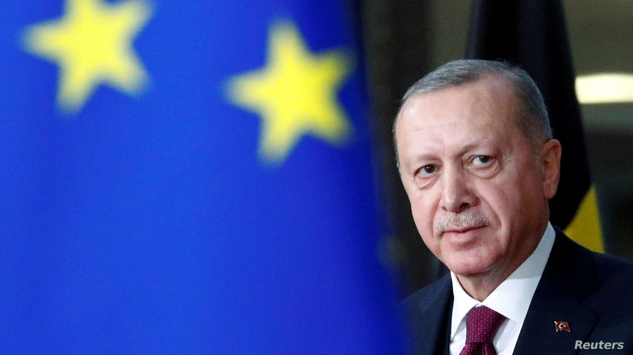 FILE PHOTO: Turkish President Tayyip Erdogan arrives for a meeting with EU Council President Charles Michel in Brussels,…