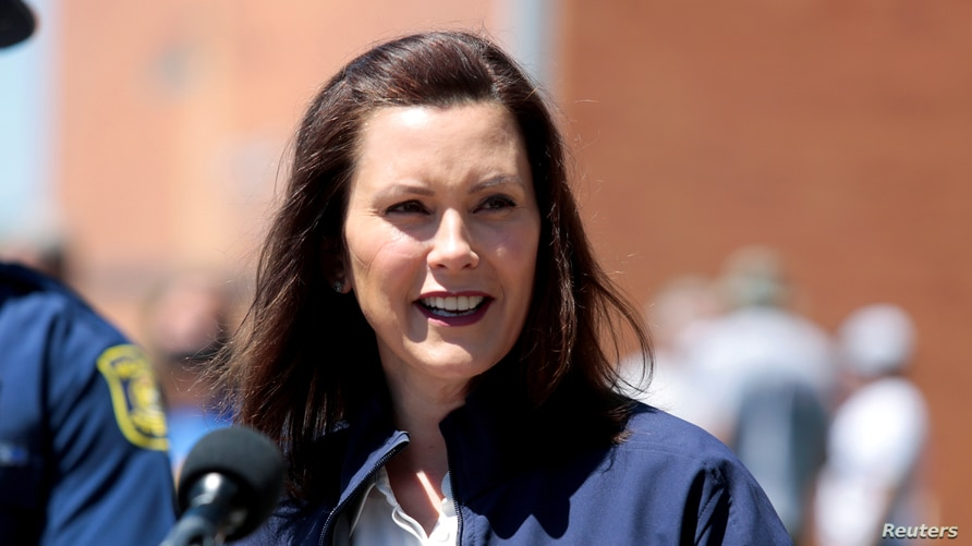 FILE PHOTO: Michigan Governor Gretchen Whitmer addresses the media about the flooding along the Tittabawassee River, after…