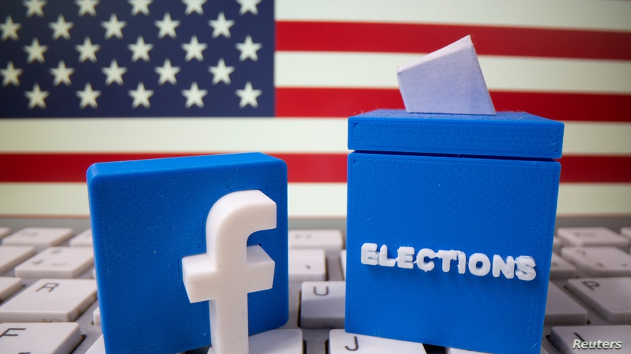 FILE PHOTO: A 3D-printed elections box and Facebook logo are placed on a keyboard in front of U.S. flag in this illustration…
