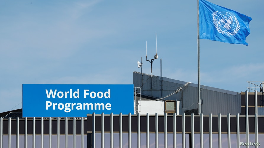 A World Food Program's flag flutters on the roof of WFP's headquaters after the WFP won the 2020 Nobel Peace Prize, in Rome,…