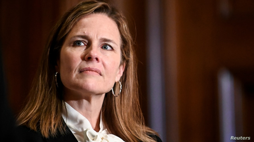 FILE - Judge Amy Coney Barrett, U.S. President Donald Trump's nominee to the Supreme Court, attends a meeting with U.S. Senator Kevin Cramer (R-ND) on Capitol Hill in Washington, Oct. 1, 2020.