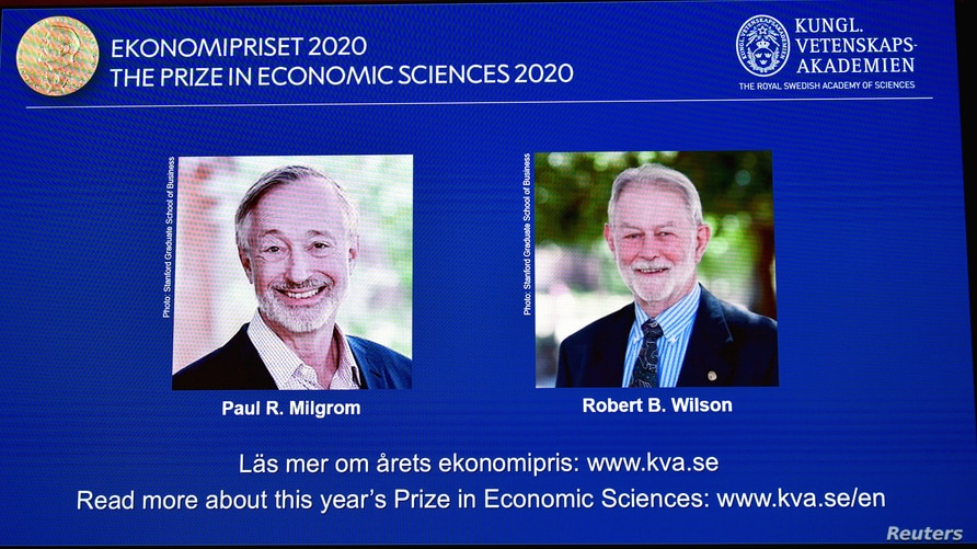 Pictures of the winners of the 2020 Nobel prize in economic sciences, Paul R. Milgrom and Robert B. Wilson, are displayed on a…