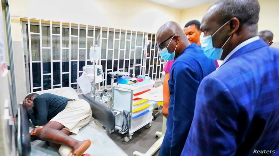 Lagos State Goveror Babajide Sanwo-Olu visits injured people at a hospital in Lagos, in this handout photo.