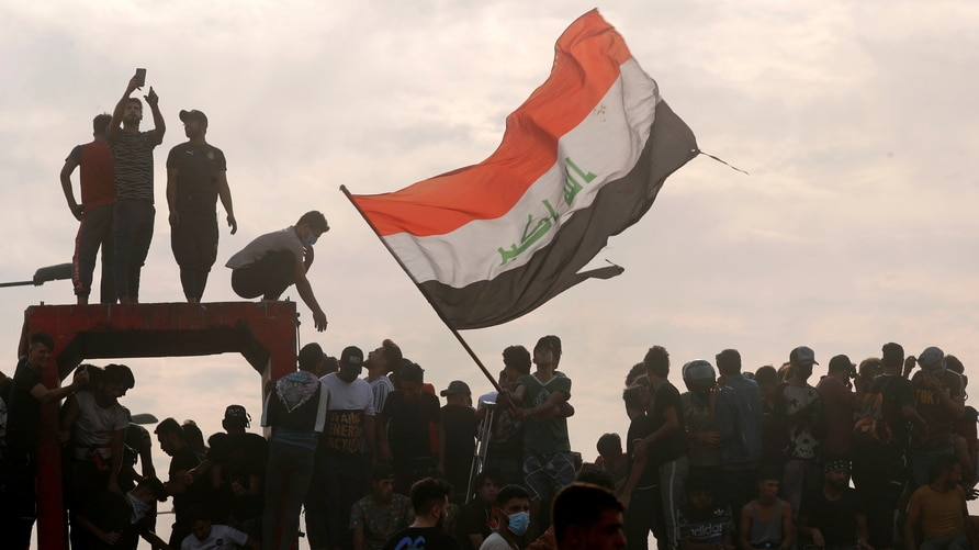 Iraqi demonstrators gather to mark the first anniversary of the anti-government protests in Baghdad, Iraq October 25, 2020…