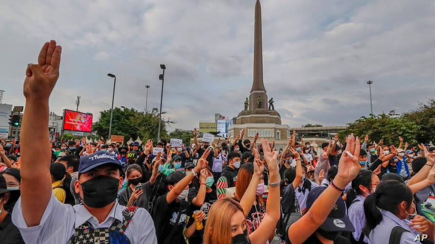 Pro-democracy activists flash three-fingered salute during a demonstration at Victory Monument in Bangkok, Thailand, Wednesday,…