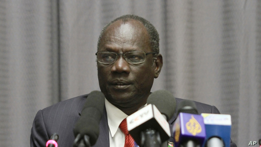 FILE - In this Sunday, Jan. 5, 2014 file photo, South Sudan's information minister Michael Makuei attends a press conference in…