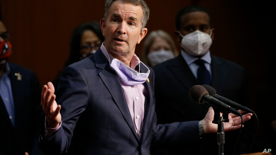In this June 4, 2020 file photo Virginia Gov. Ralph Northam speaks during a news conference in Richmond, Va.  Northam announced…