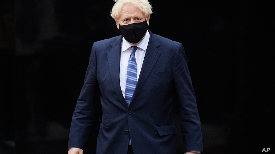 Britain's Prime Minister Boris Johnson visits the headquarters of Octopus Energy in London, Oct. 5, 2020.