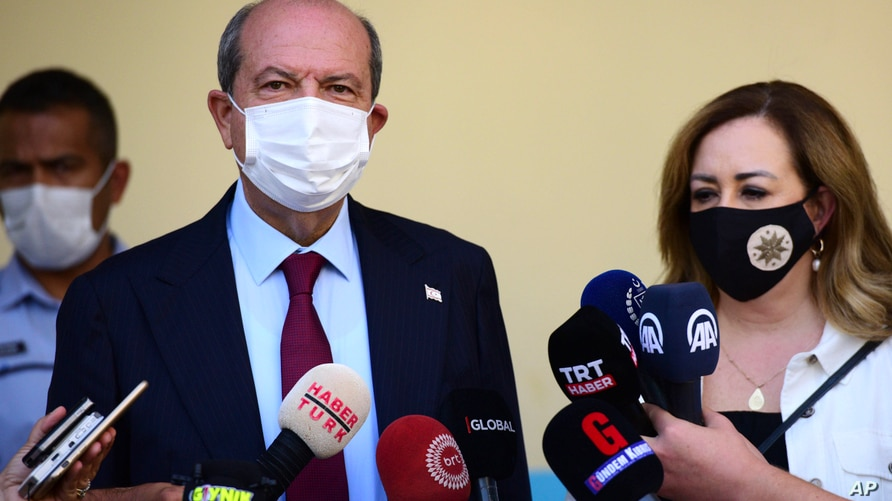 Ersin Tatar candidate and prime minister of a self-declared Turkish Cypriot state recognized only by Turkey with his wife Sibel Tatar speak to the media in the Turkish occupied area in the north part of the divided capital Nicosia, Oct. 18, 2020.