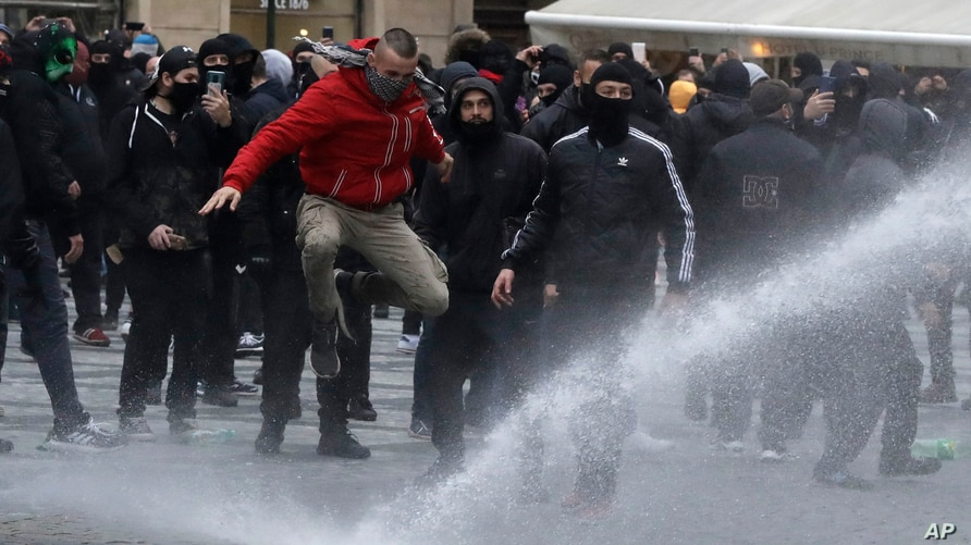 Water canon is used against demonstrators as they gather to protest against the COVID-19 restrictive measures at Old Town Square in Prague, Czech Republic, Oct. 18, 2020.