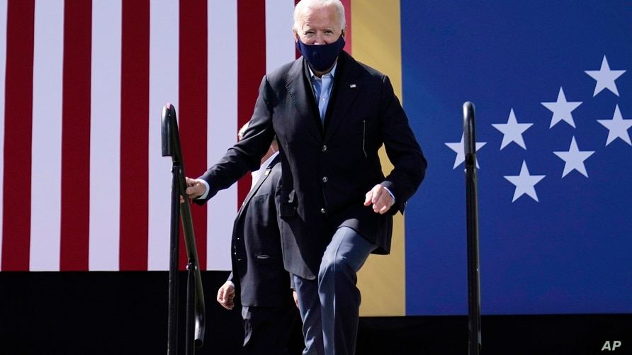 Democratic presidential candidate former Vice President Joe Biden arrives to speak during a campaign event at Riverside High School in Durham, N.C., Oct. 18, 2020.