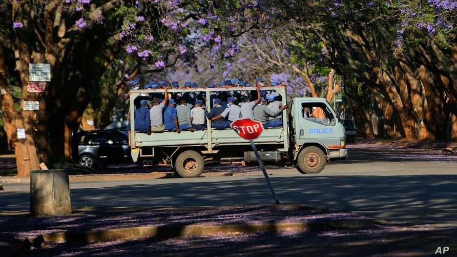 A truck carrying police officers on a street in Harare, Oct, 19, 2020.