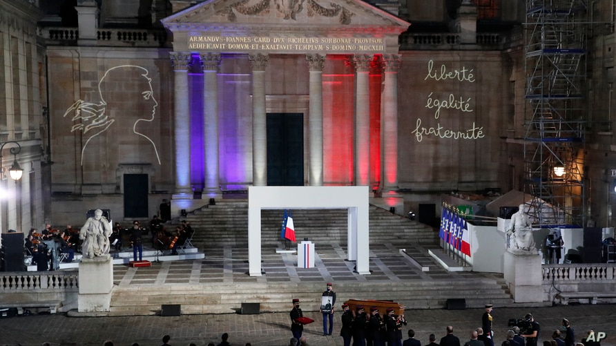 The coffin of slain teacher Samuel Paty is carried away in the courtyard of the Sorbonne university during a national memorial event, Oct. 21, 2020 in Paris.