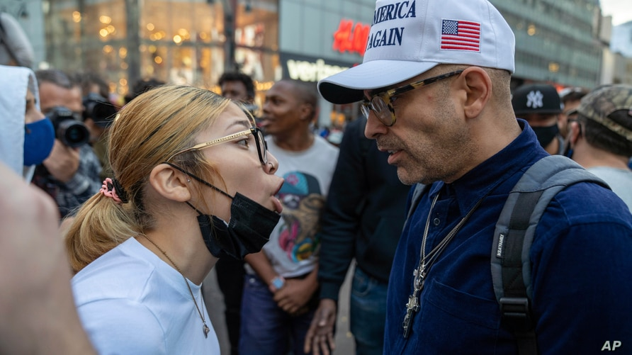 Trump supporters and anti-Trump protesters collide at a rally in New York City on Oct. 24, 2020.