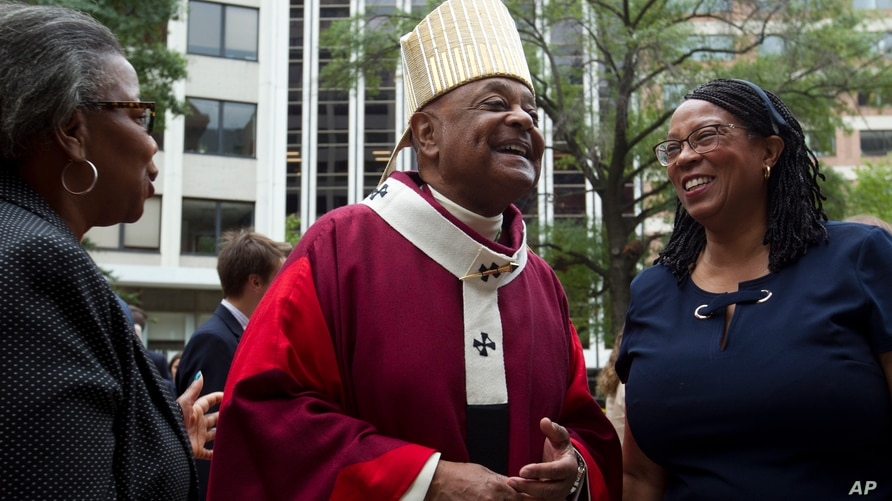 FILE  - In this Sunday Oct. 6, 2019, file photo, Washington D.C. Archbishop Wilton Gregory greets churchgoers at St. Mathews Cathedral after the annual Red Mass in Washington.