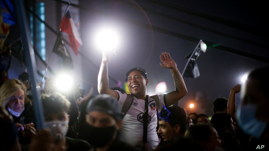 People gather at Plaza Italia on the day Chileans voted in a referendum to decide whether the country should replace its 40-year-old constitution, written during the dictatorship of Gen. Augusto Pinochet, in Santiago, Oct. 25, 2020.