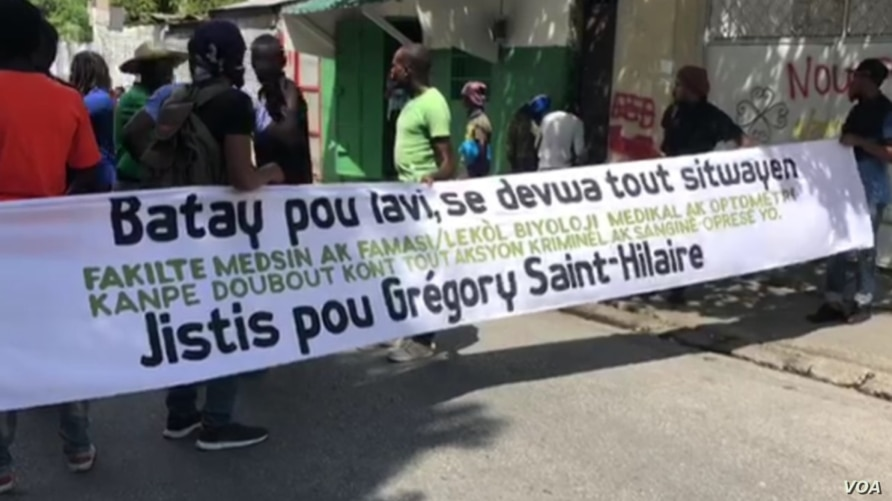 University students protest in Port-au-Prince, Haiti to demand justice for Gregory Saint-Hilaire who was shot and killed by poli