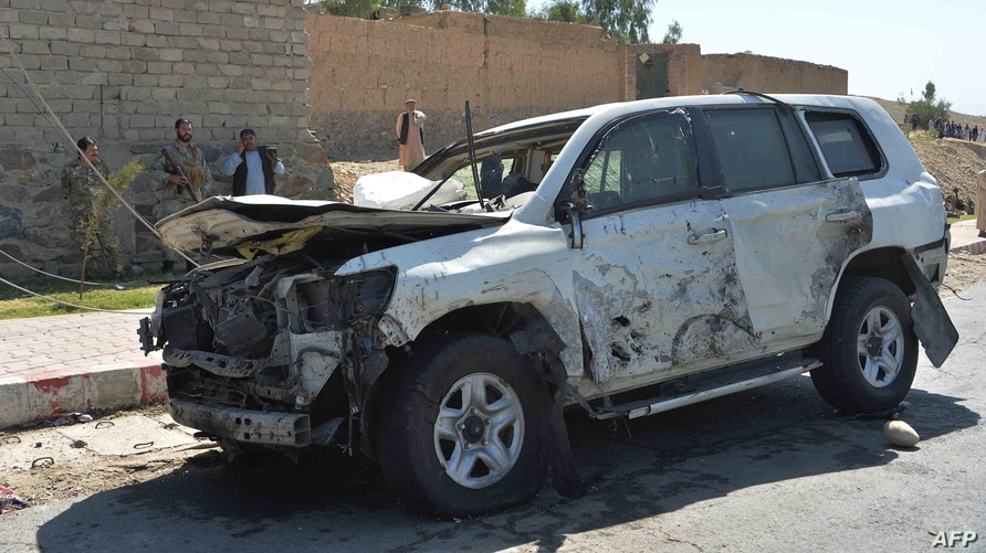 Afghan security forces inspect the site of a car bomb attack that targeted Laghman provincial governors convoy, in Mihtarlam, Laghman Province, Oct. 5, 2020.