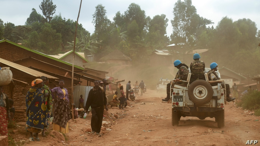 FILE - Soldiers from the U.N. mission in the Democratic Republic of Congo (MONUSCO) ride in a vehicle as they patrol in the violence-torn Djugu region, in Ituri province, eastern DRC, March 13, 2020.