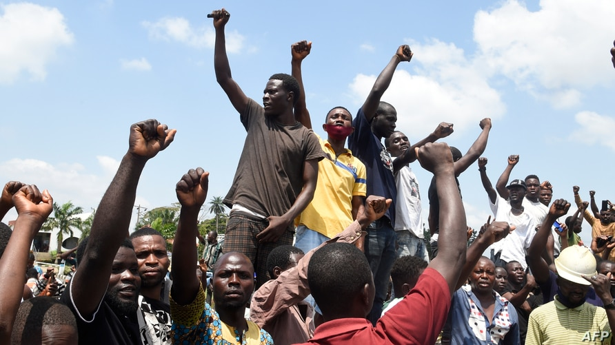 Protesters chant solidarity songs as they block the Lagos-Ibadan expressway, railing against police brutality and the killing of protesters by the military, at Magboro, Ogun state, Nigeria, Oct. 21, 2020.