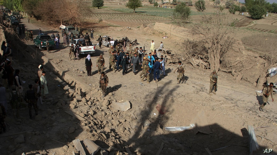 Security personnel arrive at the site of a truck bomb attack in Ghanikhil district, Nangarhar province, east of Kabul, Afghanistan, Oct. 3, 2020.