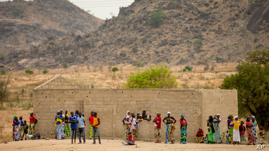 FILE - Villagers are seen gathered in Maroua, northern Cameroon, April 18, 2016. Boko Haram militants have again been stepping up attacks in the northern part of the country in recent months.
