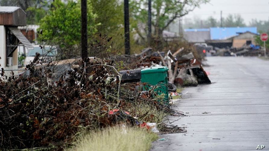 Debris sits near a street after Hurricane Laura hit nearly a month ago ahead of Hurricane Delta, in Lake Charles, Louisiana, Oct. 9, 2020.
