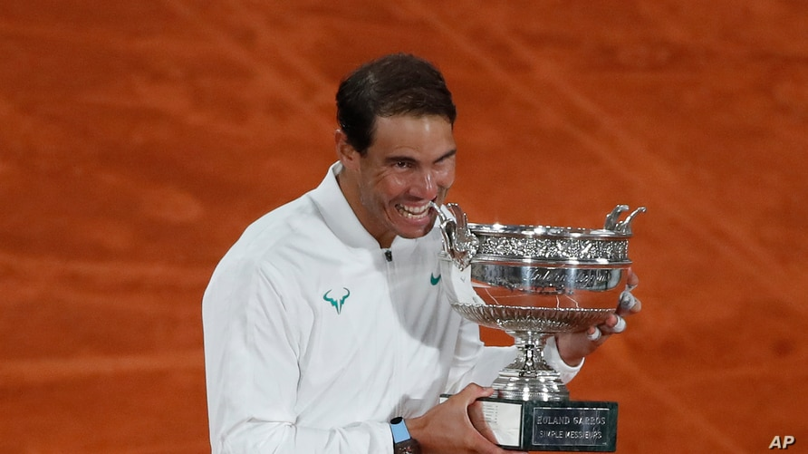 Spain's Rafael Nadal celebrates winning the final match of the French Open tennis tournament against Serbia's Novak Djokovic in three sets, 6-0, 6-2, 7-5, at the Roland Garros stadium in Paris, France, Oct. 11, 2020.