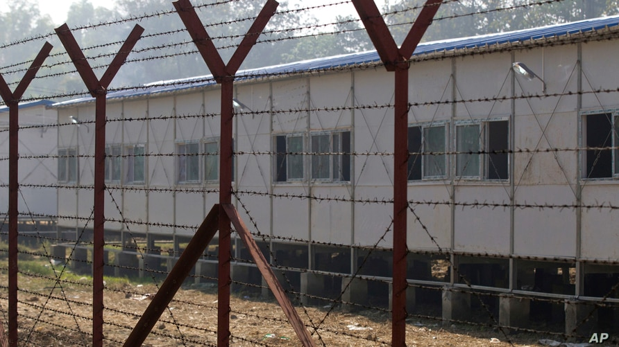 FILE - Newly-built repatriation camps prepared for Rohingya refugees expected to return from Bangladesh are surrounded by barbed-wire, Jan. 24, 2018, in Taungpyo township, border town of northern Rakhine State, Myanmar.