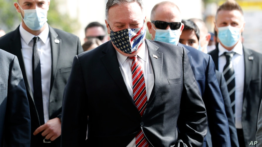 U.S. Secretary of State Mike Pompeo, center, wearing a mask, is seen during a walking tour of Dubrovnik's Old Town, Croatia, Oct. 2, 2020. Pompeo visited Croatia as part of his six-day trip to Southern Europe.