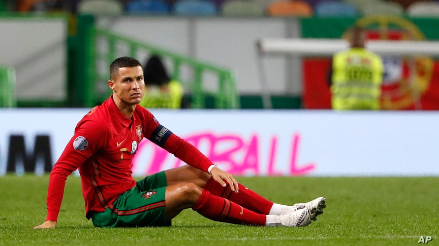 FILE - Portugal's Cristiano Ronaldo sits on the pitch during a soccer match between Portugal and Spain at the Jose Alvalade stadium in Lisbon, Oct. 7, 2020.