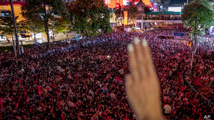 A pro-democracy protester flashes a three-finger salute, a symbol of resistance, during an anti-government rally in the central business district of Bangkok, Thailand, Oct. 15, 2020.