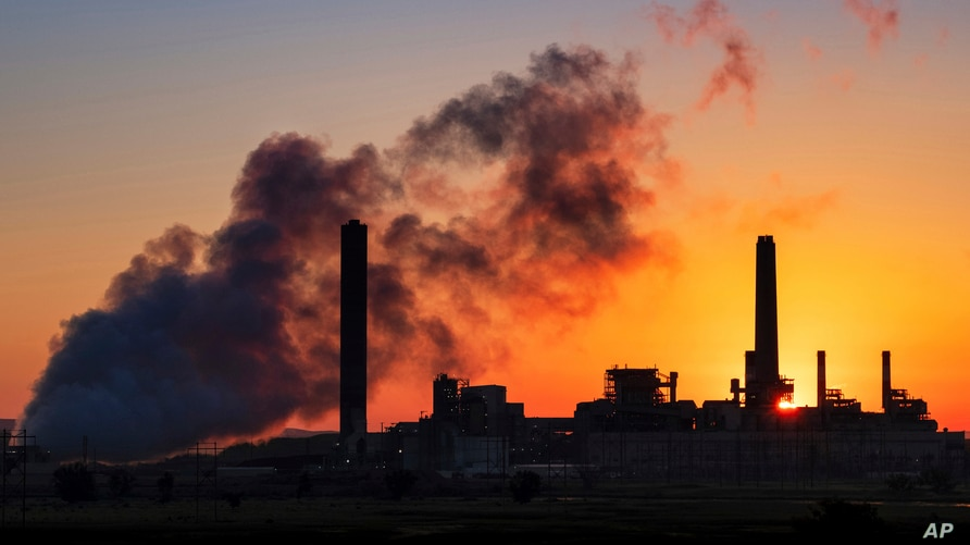 FILE - The Dave Johnson coal-fired power plant is silhouetted against the morning sun in Glenrock, Wyoming, July 27, 2018.