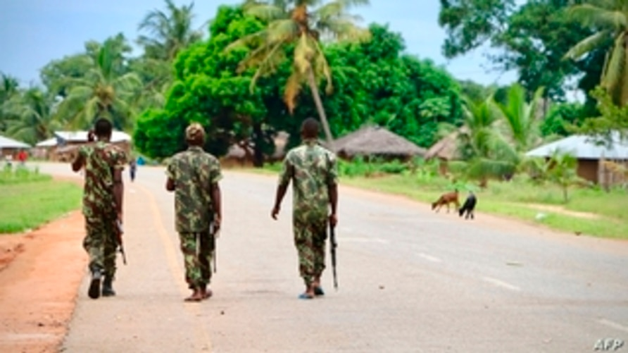 (FILES) In this file photo taken on March 07, 2018 Soldiers from the Mozambican army patrol the streets after security in the…